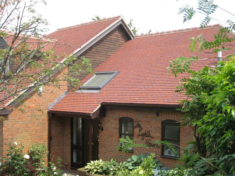 Detatched house with double garage and red roof tiles